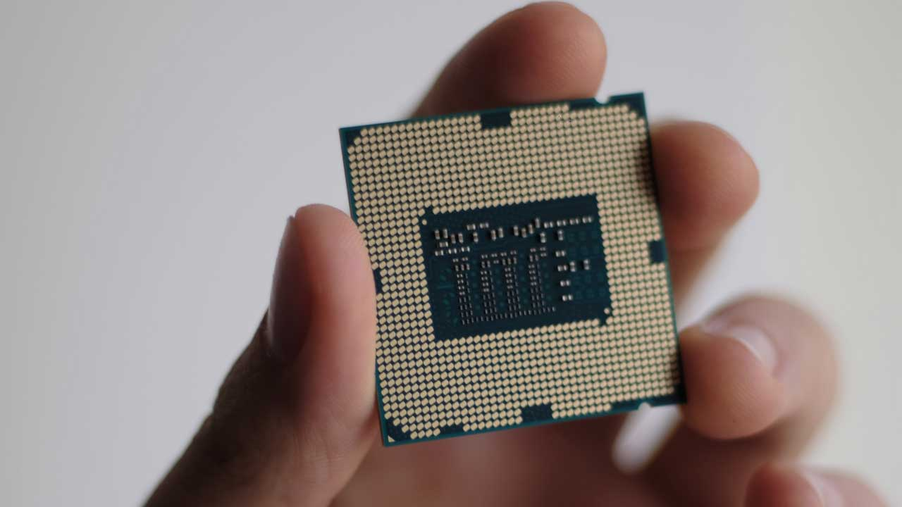 person holding a processor or CPU